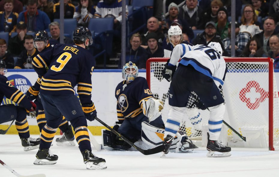 Winnipeg Jets right wing Blake Wheeler scores the game-winning goal against Buffalo Sabres goaltender Carter Hutton  in the third period on Sunday. (James P. McCoy/Buffalo News)
