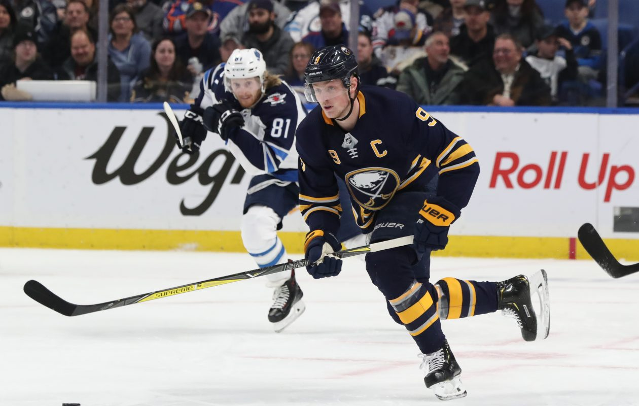 Jack Eichel battles Winnipeg's Kyle Connor  for the puck in the first period. (James P. McCoy/Buffalo News)