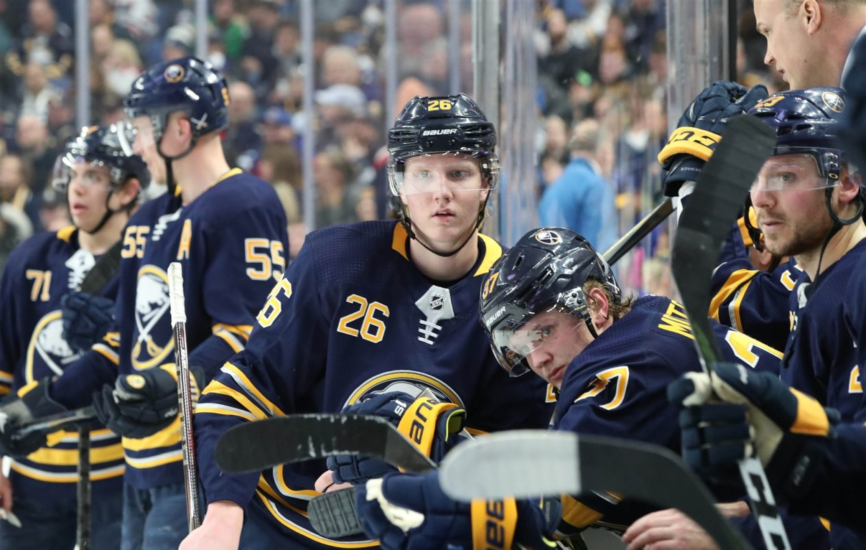 Rasmus Dahlin and Casey Mittelstadt were among the eight new players on the Sabres' roster to open the season. (James McCoy/Buffalo News)
