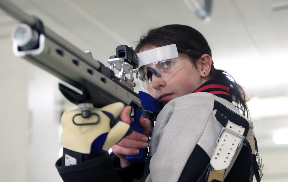 Clarence High School's Alexis Kirk shoots her rifle at Kenmore East High School. (Harry Scull Jr./Buffalo News)