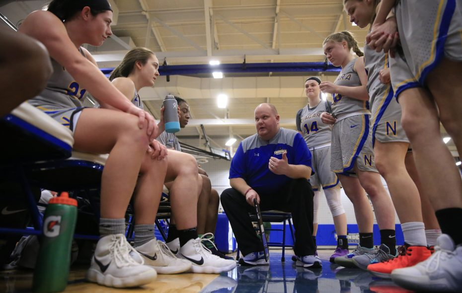 Niagara County Community College players listen to head coach Nate Beutel (Harry Scull Jr./ Buffalo News)