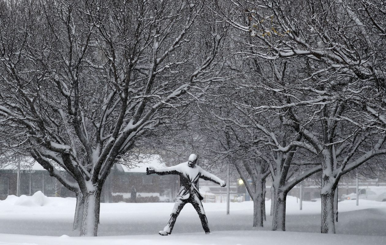 The Jimmy Griffin statue covered in snow outside Sahlen Field, in Buffalo Wednesday, Jan. 30. (Mark Mulville/Buffalo News)