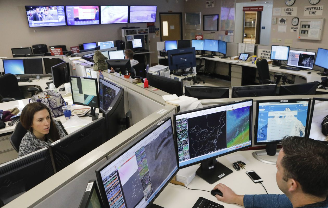 Meteorologists Heather Kenyon and Michael Fries track a wide variety of data sets at the National Weather Service office near the airport in Cheektowaga.   (Derek Gee/Buffalo News)