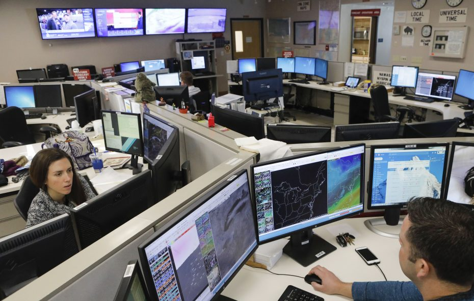 Meteorologists Heather Kenyon and Michael Fries track a wide variety of data sets at the National Weather Service office near the airport in Cheektowaga. (Derek Gee/News file photo)