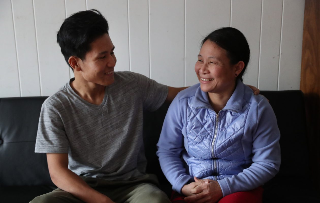 Ehkalue Soe, a 21-year-old Karenni refugee from Burma, became a U.S. citizen last month. His mother Julia Bu, right, became a citizen last October. Buffalo's ability to fill jobs will depend to a great extent on its ability to attract and help settle refugees and other immigrants. (Sharon Cantillon/Buffalo News)