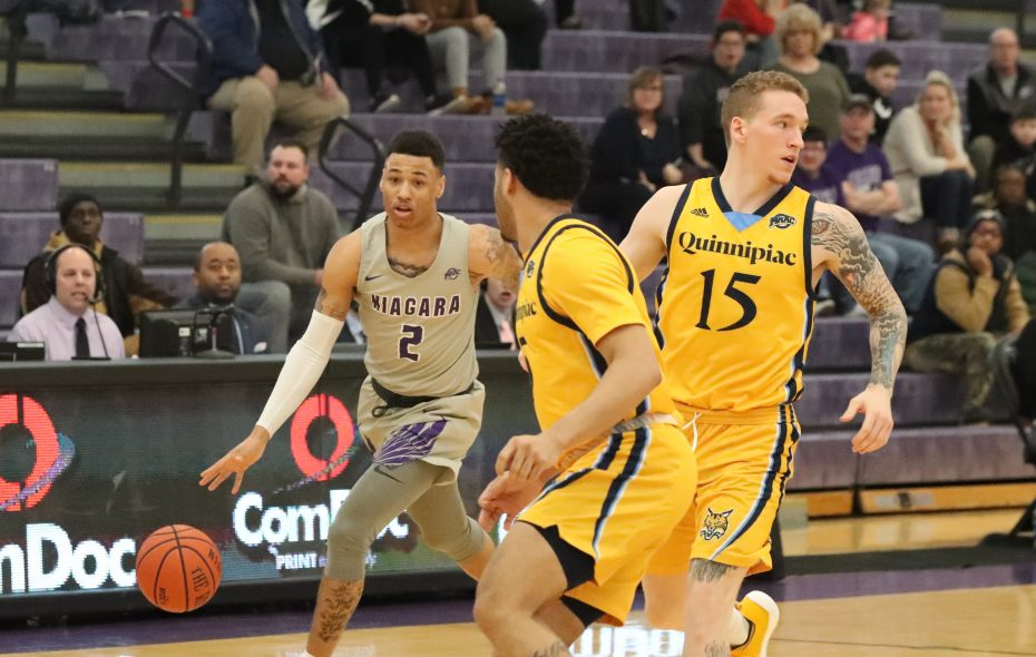 Niagara's Keleaf Tate  scores two points over Quinnipiac's Travis Atson in the first half (James P. McCoy/Buffalo News)