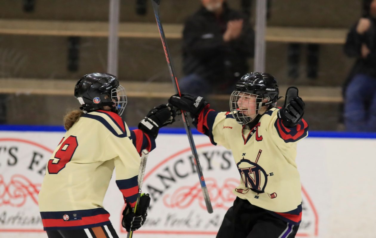 Williamsville forward Jenna Cavalieri celebrates with her teammates after she scored a goal in the first period of a 6-1 win against Potsdam on Friday at HarborCenter. (Harry Scull Jr./The Buffalo News)