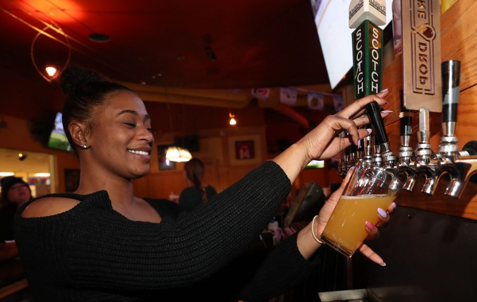 Tonawanda Bowling Center bartender Anjanett Edmonds pours a Guava Sutra Milkshake IPA Batch #2 by Three Heads Brewing out of Rochester. (Sharon Cantillon/Buffalo News)