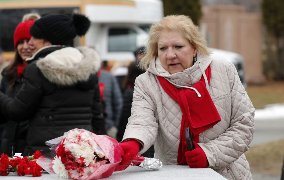 Justine Krasuski lays from flowers after a remembrance ceremony in Forest Lawn Cemetery on Monday, Feb. 11, 2019, for those who lost their lives on Flight 3407 10 years ago. (Mark Mulville/Buffalo News)