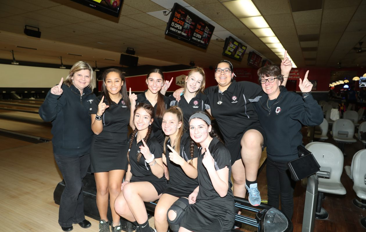 The Division I champion Orchard Park bowling team are front row, left to right: Paige Bartosz, Emily Brock, Christa Perrin. Back row: coach Kim Caligiuri, Sara Radt, Olivia Dauer, Olivia Bartosz, Alexis Klenke and assistant coach Ruth Wooliver. (James P. McCoy/Buffalo News)