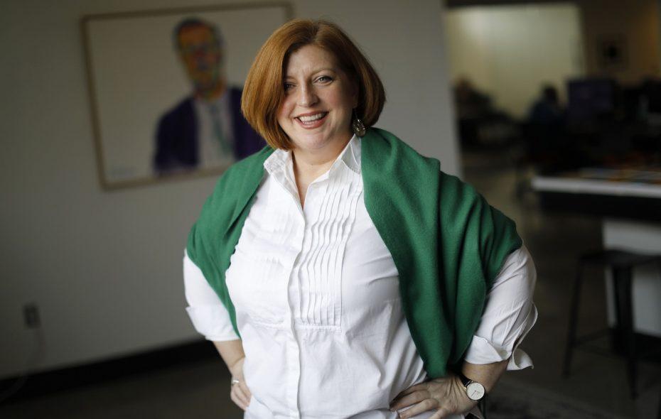 Jennifer K. Fortune, media director at FIFTEEN on Delaware Avenue, wears a favorite shirt and wrap. (Derek Gee/Buffalo News)