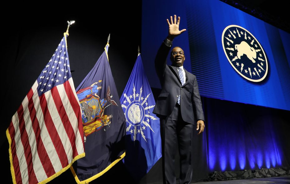 Mayor Byron Brown  waves to the audience as he exits the stage following his annual State of the City address at the Buffalo Niagara Convention Center. (Sharon Cantillon/Buffalo News)