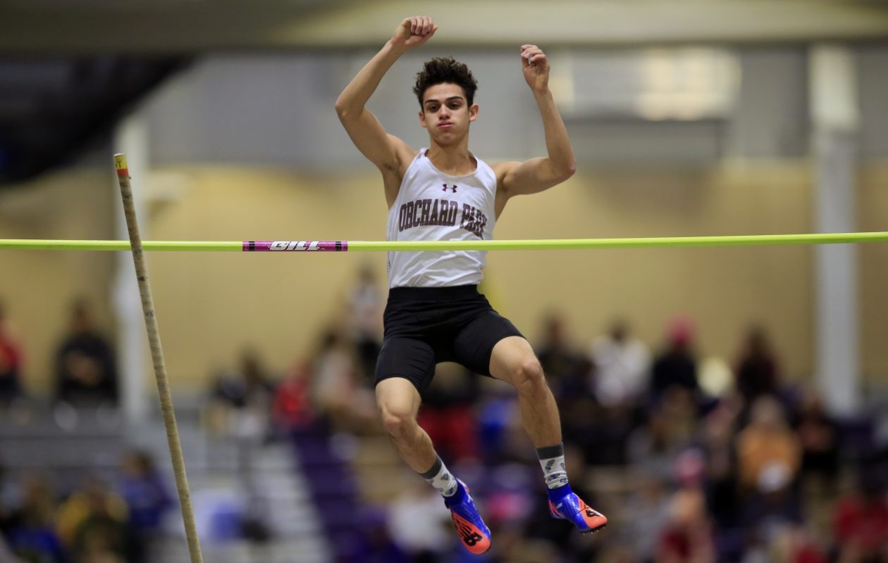 Nino Rivera from Orchard Park clears 11'6 in the pole vault (Harry Scull Jr./Buffalo News)