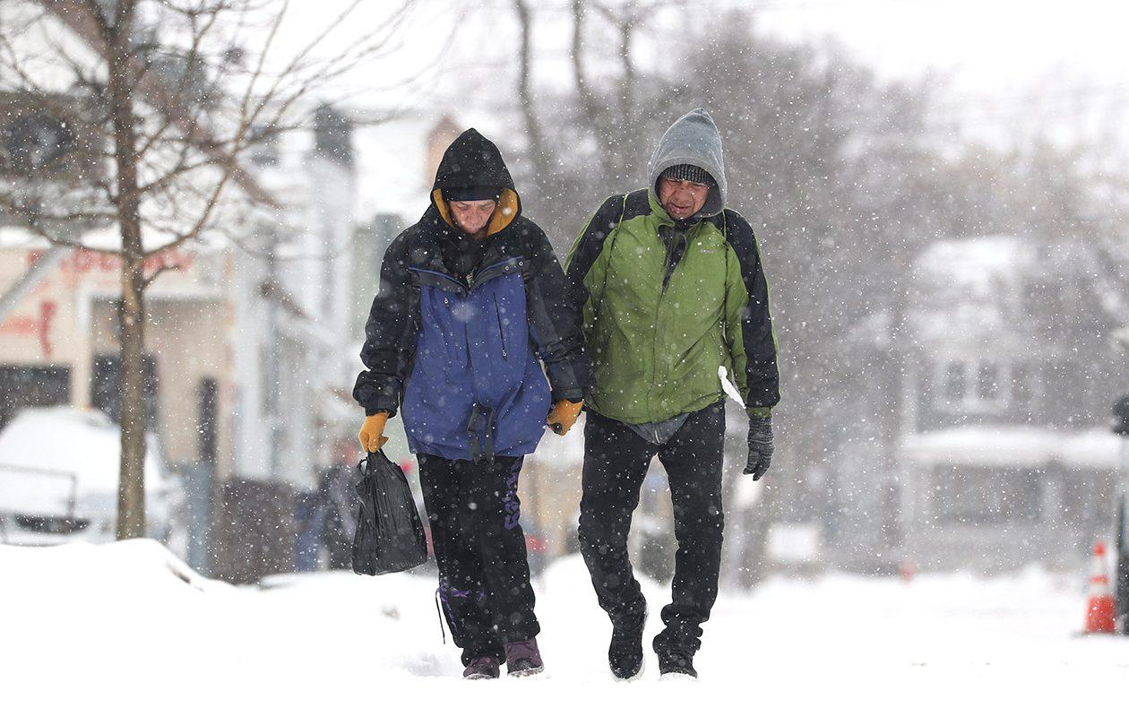 Tara and Darryl Spruce take a walk up Herkimer Street in Buffalo on Feb. 18. (Sharon Cantillon/Buffalo News)