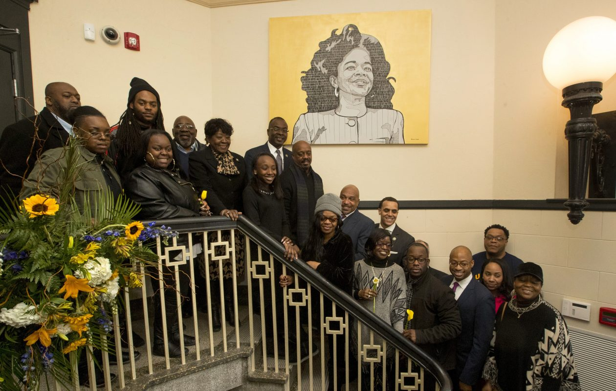 Mayor Byron Brown, Council President Darius Pridgen and family members of Beverly Gray unveiled her portrait at the Beverly Gray Business Exchange Center. (John Hickey/Buffalo News)