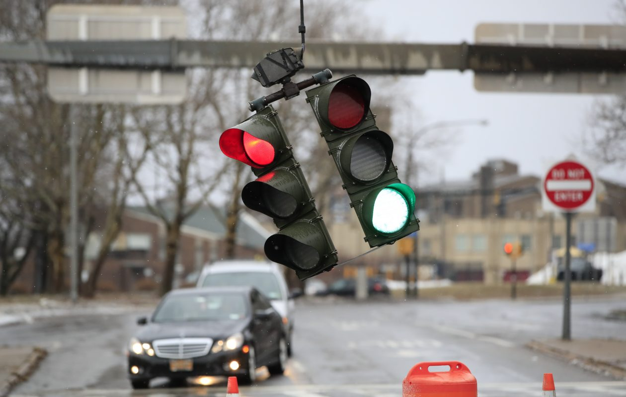 A traffic light hangs on the corner of Lower Terrace and Church Street in Buffalo earlier this winter during a windstorm. (Harry Scull Jr./Buffalo News file photo)
