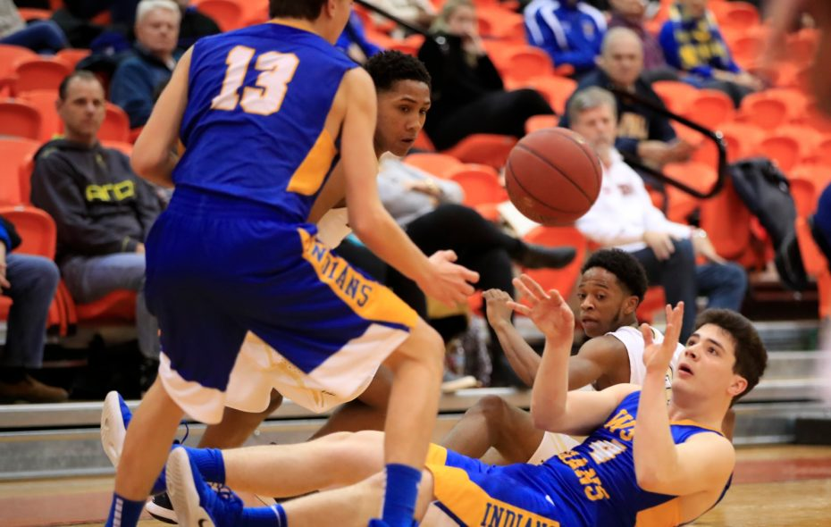 West Seneca West's Nate Ryniec passes to Daric Rivera against Sweet Home during the first half of the Section VI, A1 semifinal Thursday at the Buffalo State Sports Arena. (Harry Scull Jr./Buffalo News)