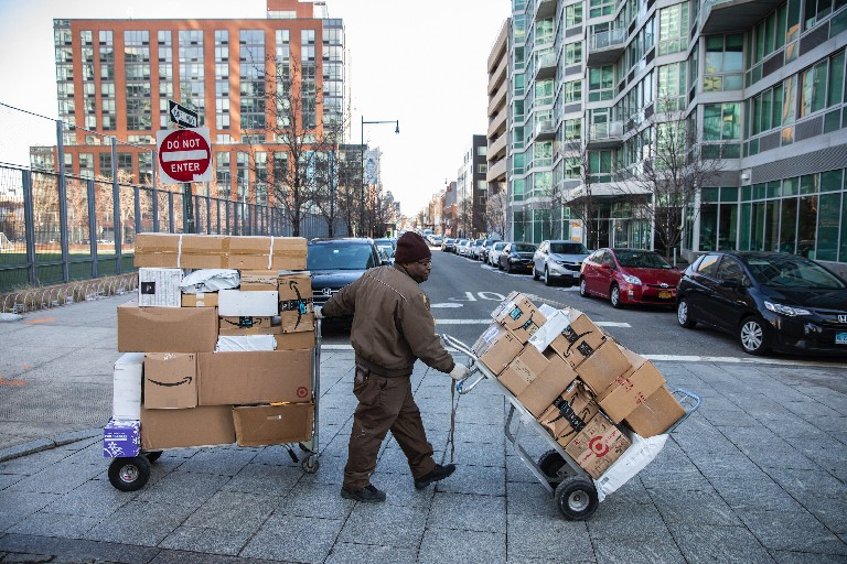 A UPS driver delivers packages in Long Island City on Thursday, the same day Amazon canceled plans to build its corporate campus there. (New York Times)