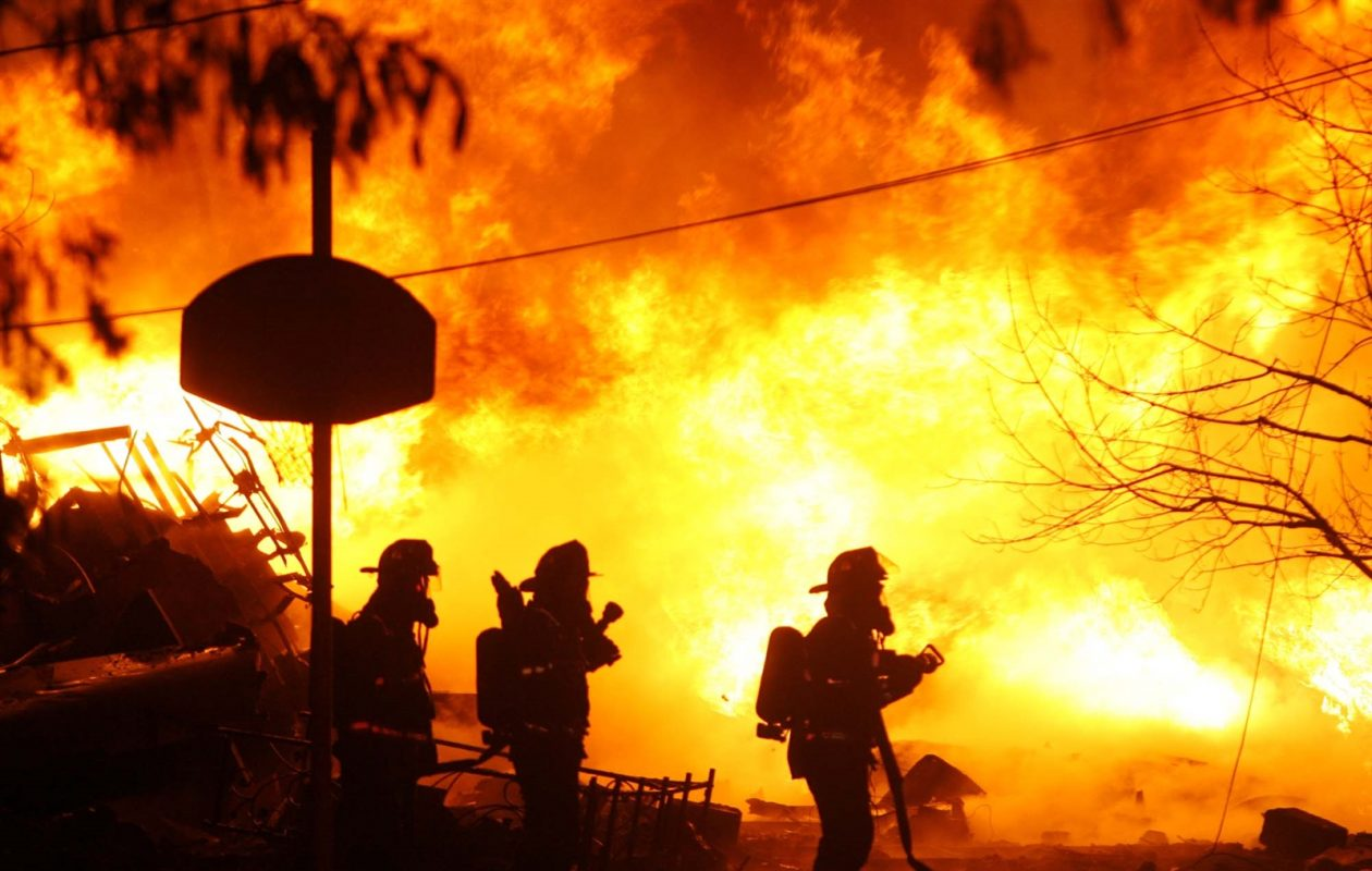 Firefighters at the scene in Clarence Center after Flight 3407 crashed into a house, killing all 49 aboard and one on the ground on Feb. 12, 2009. (Harry Scull Jr./Buffalo News file photo)