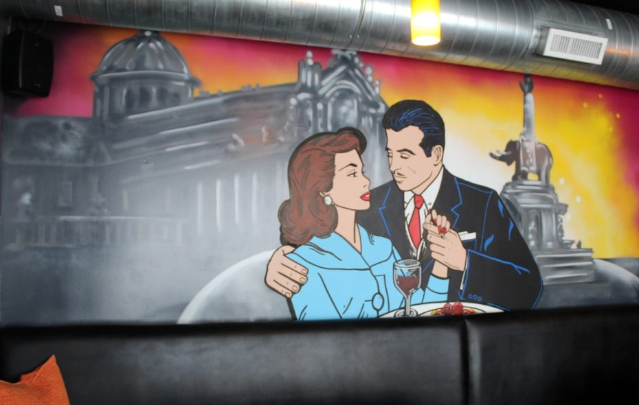 New Niagara Falls southern Italian/Sicilian restaurant Catania boasts a large mural of a couple dining in front of the Piazza del Duomo in Catania, Sicily. (via Catania restaurant)