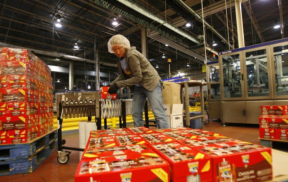 Worker Nicole Kondziela loads cartons of drink boxes onto a pallet at Steuben Foods in Elma. (Derek Gee/News file photo)