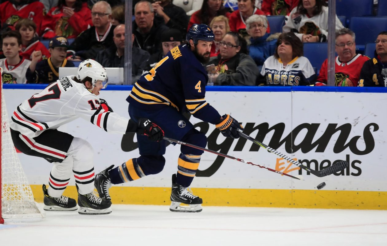 Zach Bogosian works the puck against Chicago's Dylan Strome during the first period Friday night against the Blackhawks.(Harry Scull Jr./Buffalo News)