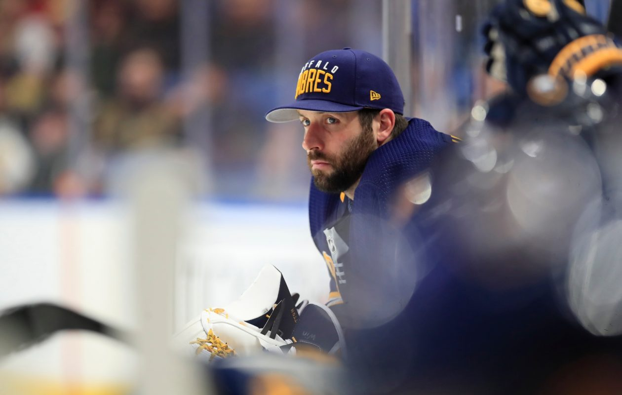 A grim-faced Carter Hutton watches the third period from the bench after he was pulled from the game (Harry Scull Jr./Buffalo News).