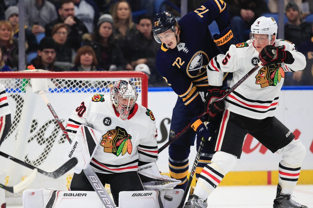Sabres winger Tage Thompson fights for a loose puck in front of Blackhawks goalie Cam Ward during the first period Friday night. (Harry Scull Jr./Buffalo News)