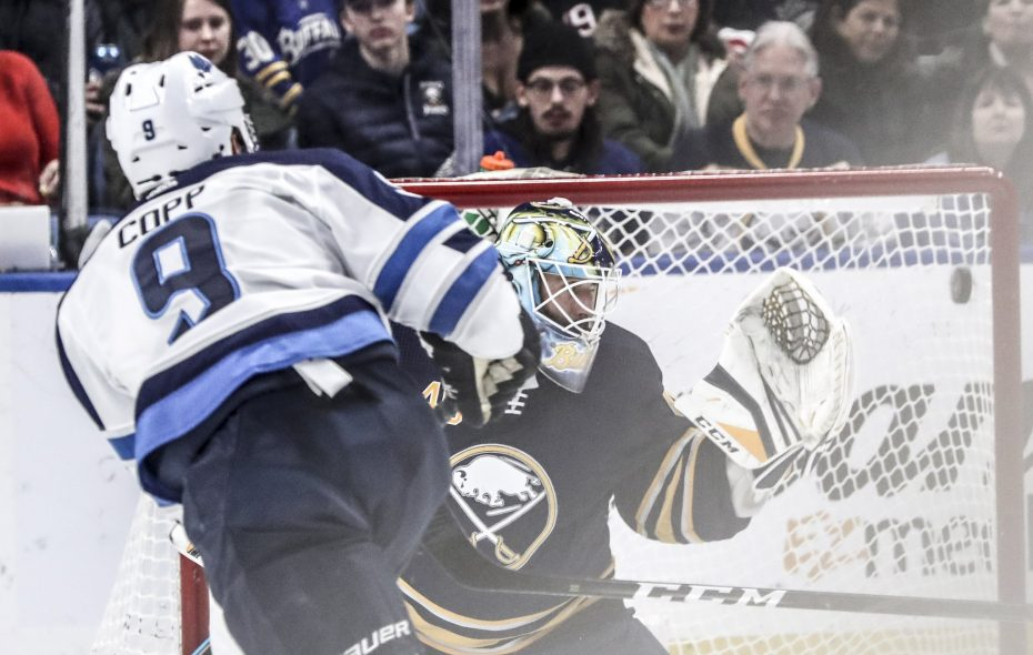 Winnipeg Jets center Andrew Copp scores a goal against Buffalo Sabres goaltender Carter Hutton in the second period at KeyBank Center in on Sunday. (James McCoy/Buffalo News)