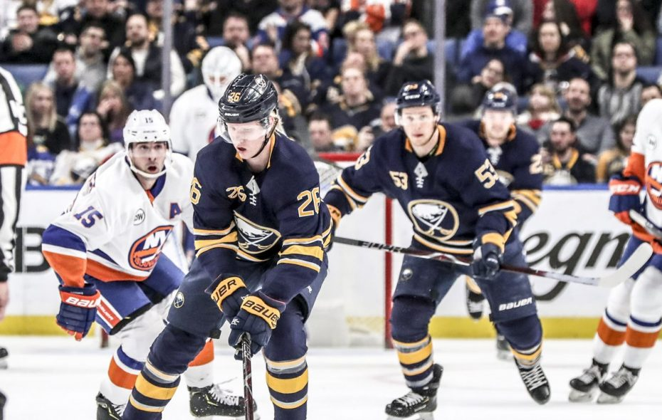Sabres defenseman Rasmus Dahlin (26) battles New York Islanders winger Cal Clutterbuck (15) for the puck in the second period at KeyBank Center in Buffalo, NY on Tuesday, Feb. 12, 2019. (James McCoy/Buffalo News)