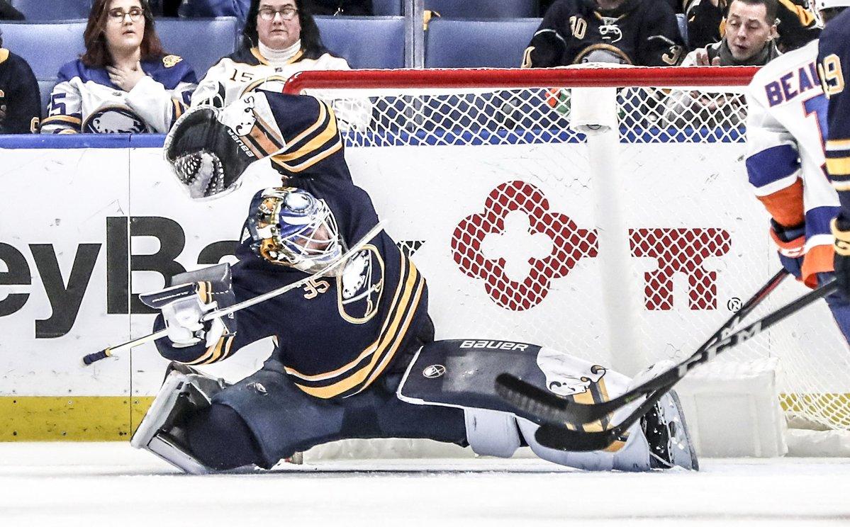 Buffalo Sabres goaltender Linus Ullmark (35) makes a save on a shot from New York Islanders center Mathew Barzal (13) in the third period at KeyBank Center in Buffalo, NY on Tuesday, Feb. 12, 2019. (James McCoy/Buffalo News)