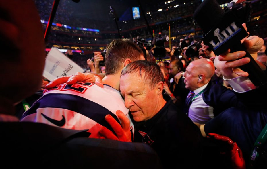 A Gatorade-soaked Bill Belichick hugs Tom Brady after yet another Super Bowl win. (Photo by Kevin C. Cox/Getty Images)