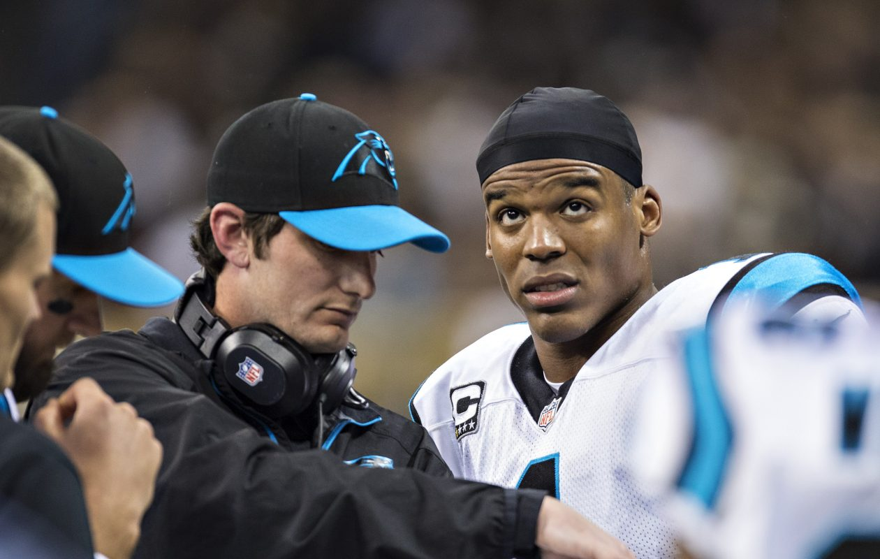 Carolina quarterbacks coach Ken Dorsey talks to Cam Newton on the sideline (Wesley Hitt/Getty Images)