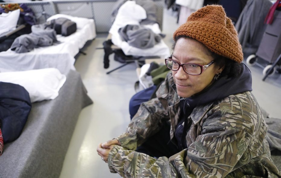 Marguerite Redding passes the time in the shelter at Holy Cross Church, which normally closes during the day but is staying open as a warming center during the blizzard, Thursday, Jan. 31, 2019. (Derek Gee/Buffalo News)
