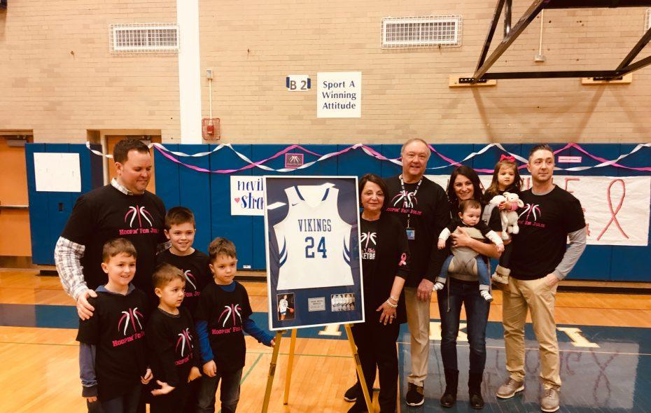 Julie Anne Neville's No. 24 jersey was retired by Grand Island High School on Friday night. (Jonah Bronstein)