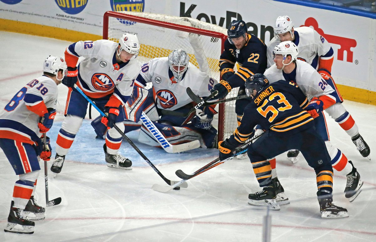 Goalie Robin Lehner and his defense swarm Sabres forwards Jeff Skinner (53) and Johan Larsson during the New York Islanders' 3-1 win over the Sabres Dec. 31 in KeyBank Center. (Robert Kirkham/Buffalo News)