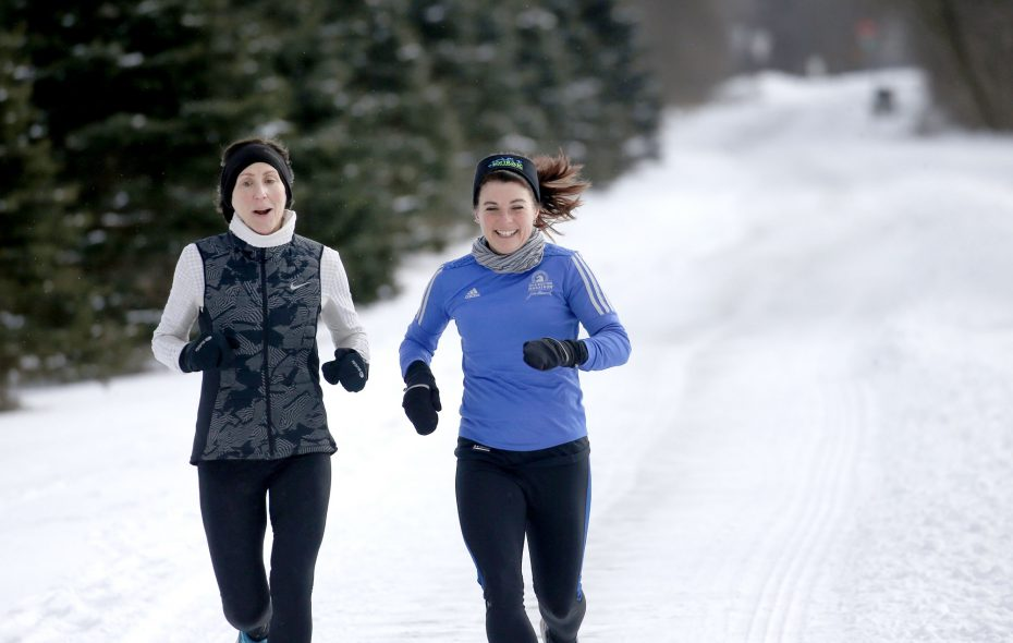 """I don't like getting up early whether I'm running or not. I figure I might as well get up for some good,"" says Kathy Reynolds, right, of Amherst, who runs regularly with friends, including Teresa Darlak, left. (Robert Kirkham/Buffalo News)"