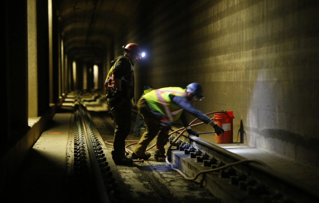 Crews perform maintenance on the Metro Rail tracks near the Utica Street station. Despite such efforts, officials say funding has not kept pace with the aging system's needs. (Mark Mulville/News file photo)