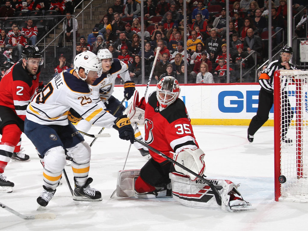 Jason Pominville hits the goalpost on a first-period power play against  Devils goaltender Cory a300154fb