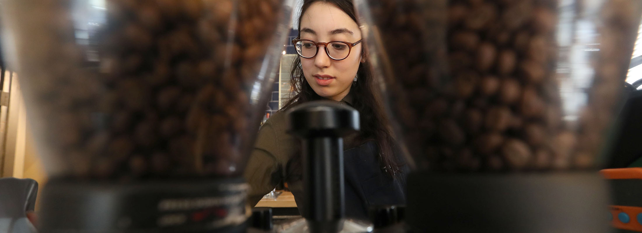 Remedy House, at 429 Rhode Island St. Barista D. Sloan prepares coffee. (Sharon Cantillon/Buffalo News)