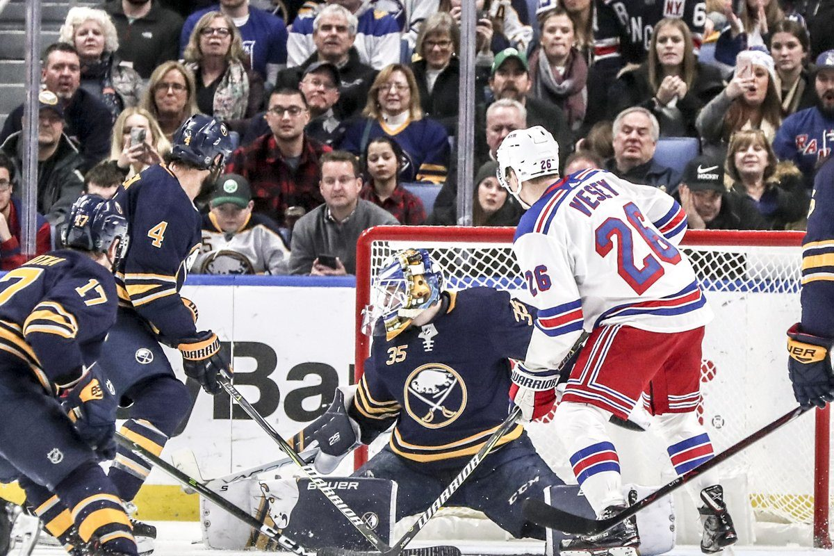 Sabres Vladimir Sobotka (17), Zach Bogosian (4) and goalie Linus Ullmark join Rangers forward Jimmy Vesey (26) in watching Pavel Buchnevich's goal that gave New York a 4-2 lead in the third period. (James P. McCoy/Buffalo News)