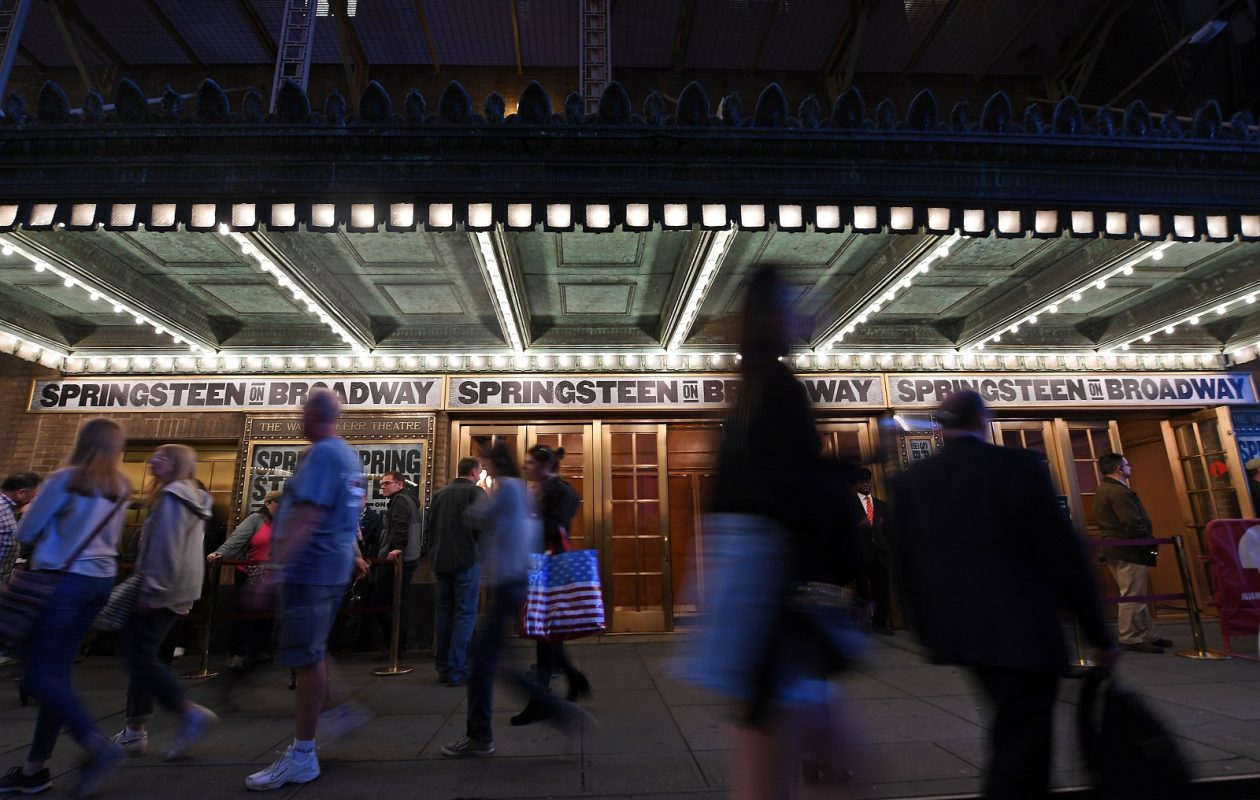 People pass by the the Walter Kerr Theater, which shows 'Springsteen on Broadway.' The year-plus residency drew worldwide interest from the rock legend's fans. (Getty Images)