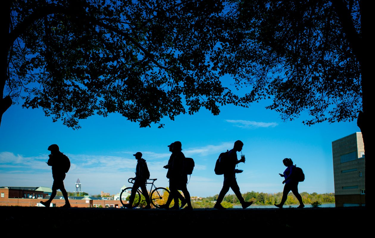 Students walk along University at Buffalo's North campus.