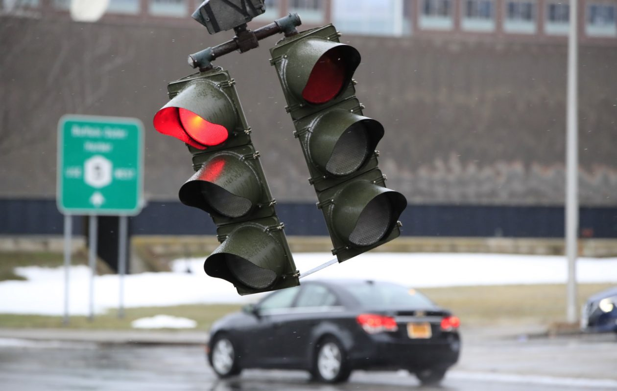 A traffic light on the corner of Lower Terrace and Church Street swayed in the most recent wind storm last month. Strong winds are possible again this weekend, forecasts show.. (Harry Scull Jr./Buffalo News file photo)