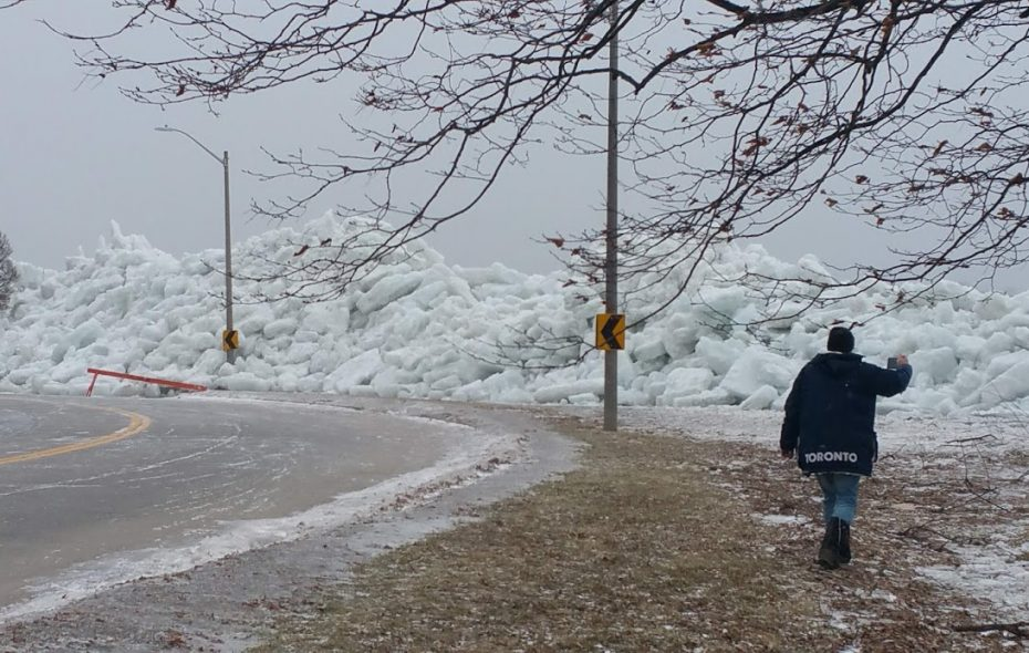 A friend of Anthony LaMonte's visits a wall of Niagara River ice in Fort Erie, Ont., where LaMonte caught stunning video of the ice crashing ashore. (Image courtesy Anthony LaMonte)