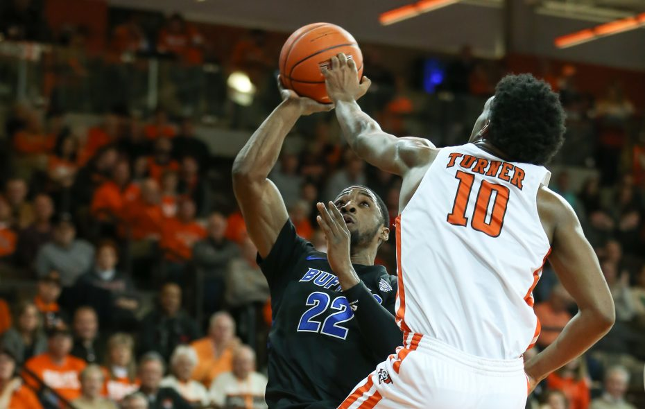 UB guard Dontay Caruthers shoots over Bowling Green guard Justin Turner during the first half of the Bull's game  at the Stroh Center in Bowling Green on Feb. 1, 2019. (Photo courtesy of Scott W. Grau)
