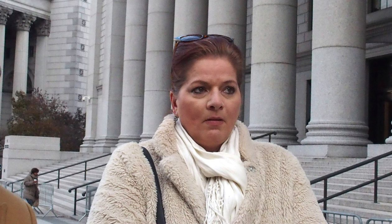 "Lisa M. Cater appears outside a Manhattan courthouse in 2017 where she filed a sexual harassment suit against former state development official Sam Hoyt.  With the suit dismissed by a judge, she says she feels defeated by the ""system."" (Special to The News)"