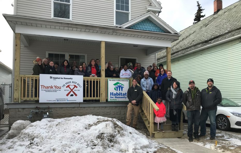 Volunteers with Habitat for Humanity Buffalo at an open house Saturday with Manasse Nsabiyuma and Nechode Ndayishimiye at the house they built through Habitat. (Courtesy of Habitat for Humanity Buffalo)