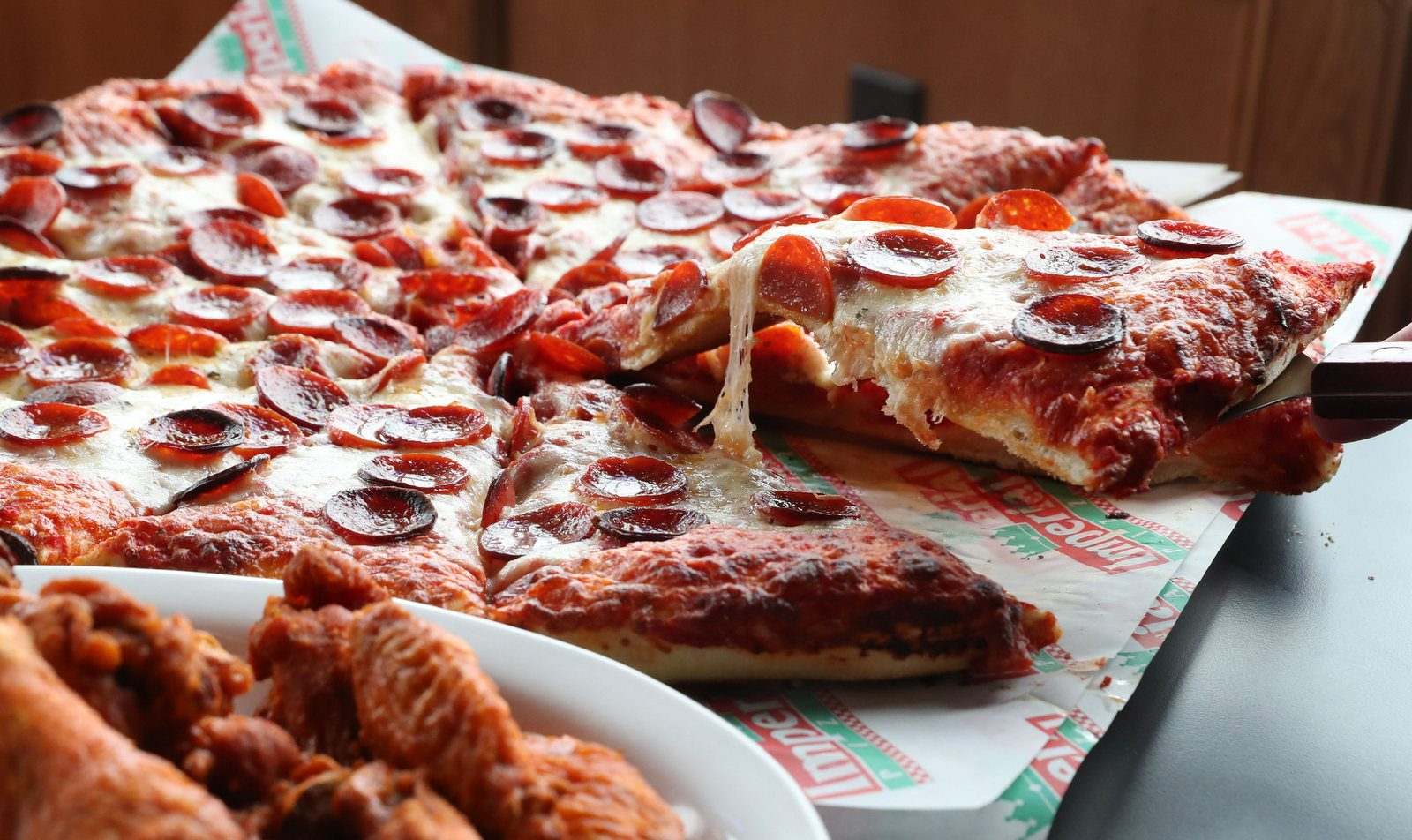 Large cheese and pepperoni pizza and a double order of hot wings at Imperial Pizza. (Sharon Cantillon/Buffalo News)