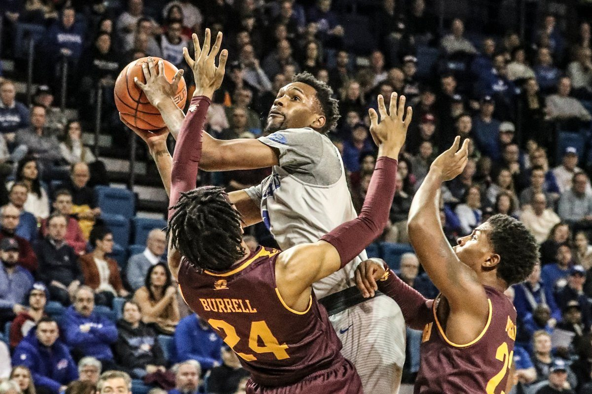 University at Buffalo forward Montell McRae scores against Central Michigan forward Romelo Burrell (24) in the first half Saturday at Alumni Arena. (James P. McCoy/The Buffalo News)